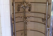 """Torture Bathroom Ideas / A """"torture bathroom"""" is my nickname for early 20th Century bathrooms that sometimes featured a huge chrome shower that had many shower heads, making it look like a torture device. These bathrooms also feature white hex and subway tile."""