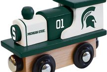NCAA Wood Toy Trains / These toy wooden trains are sure to be a hit with the young NCAA football or basketball fan in your house. Trains make a great play toy for the kids or also make for a great little display piece around the house. Ages 3+