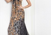 Baccio Couture Dresses / Baccio Couture Dresses are made of 100% silk and custom made to order in the USA. They are hand beaded with gorgeous Swarovski crystals. These luxurious silk dresses are truly stunning one of a kind couture dresses. #baccio #couture #dresses