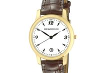 The KIKI watch / Limited edition 18ct gold Swizz Quartz movement watches, with a striking black and cream face and date dial. All watches have an inter-changeable second strap in a variety of eight fabulous colours and either 18ct yellow or rose gold.  Water resistant up to 3 ATM. Suitable for everyday use. Splash/rain resistant.