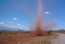 """Dust Devil & Whirlwind Fascination / I rarely see the well-formed dust devils found on the pins I have here.  We usually have smaller """"whirlwinds"""" around these parts and like in my childhood, I still like to run and get inside them if I can, lol!  Yes, the child I was is still alive and well inside of me!   Only once, when I was young, did we have a dust devil strong enough to be dangerous, it picked up our ping pong table and flung it into the side of a shed.  Fortunately, that's a rare occurrence with these wonders of nature. / by Patti Elliott Di Loreto"""