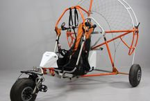 Trike Vertigo 2015 / The trike Vertigo is designed to be particularly strong and stable during all phases of takeoff and landing. Its low center of gravity makes it very stable in all the maneuvers. In flight surprises its ability to counteract the torque effect due to the rotation of the propeller. The seat is very comfortable. The front is adjustable and adapted  to the height of several pilots.  On this Trike is possible to install any paramotor Fly Products.