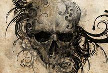 Exquisite and skulltastic tattoos.