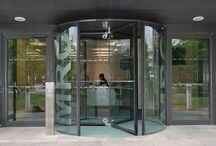 All Glass Revolving Doors / Our all-glass revolving doors can either be constructed almost entirely from glass with only stainless steel patch fixings to secure the glass panels together. Or with a thin edging frame, offered in choices of polished or brushed stainless steel, brass or bronze finishes or PPC to match any RAL colour.