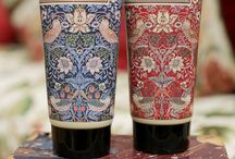 """Morris & Co. Strawberry Thief / """"Strawberry Thief"""" pattern, depicting the thrushes that Morris found stealing fruit in his kitchen garden, is from the Morris & Co. Archive. The fragrance created complements this artistic style with rich, earthy grounding scents based on sandalwood, patchouli, amber and incense oils, blended to embrace a heart of deeply restorative rose and violet, topped with notes of dew- fresh red berries, mandarin, bergamot and pepper meld together to deliver crispness with warmth."""