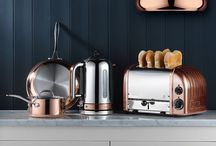 Colour Palette - Warm & Timeless / A blend of neutral darks and warm lights. Deep, raw colours for a sophisticated kitchen. The Classic Toaster in Polished is Dualit's iconic piece, and with the trend for metallics in the home showing no signs of waning, the family has been extended to include shades such as Brass and Copper. Use these to introduce a hint of the industrial, or be bold and extend to other kitchen hardware such as door handles, lighting and cookware.