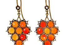 Halloween/Fall / While jewels abound in the colors orange and black, there are few that incorporate both colors in such stunning style as the following pieces.   http://www.pricescope.com/blog/6-striking-jewels-orange-and-black-all-hallows-eve-2013