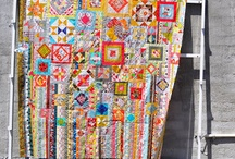 """""""Wife"""" Quilts and similars / My take: These APPEAR (because I don't really know)to be a """"Whatever I have to throw in"""" type of quilt.  A kaleidoscope of blocks and colors.. / by Sue Hook"""