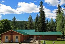 Yaak River Lodge - Price Reduced! / Yaak River Lodge is an incredible investment with 400+/- feet of river frontage. The lodge offers sleeping accommodations for 40 people, as well as a riverside cabin   Was $699,000 ~ Now Offered at $499,000!   •	7.5+/- Acres •	8 Bedrooms, 8 Bathrooms, Plus a Bunk •	6,506+/- Square Feet There are several outbuildings and garages, one of which measures 40'X30'. A darling cabin sits next to the river along with several canoes.