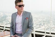 PIETER PETROS || MIAMI I / A light grey and pink checkered Summer suit with a stylish pocket square and lapel-pin.