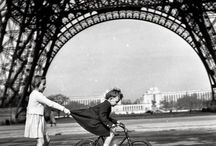 [D] Robert Doisneau [1912-1994] / Robert Doisneau was a French photographer and pioneer of photojournalism in the 1930s-1950s. He is known for his playful and ironic images of amusing juxtapositions, mingling social classes, and eccentrics in Parisian streets and cafes. He paid special attention to children's street culture.