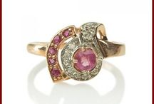 Rings / An instant heirloom is yours, in this classic ageless art deco rose gold ring that is nothing less than spectacular.  This diamond and 14kt ruby ring features a stunning bold 4MM ruby center, surrounded by a row of diamonds, further bordered on one side with a row of rubies.  This ring is finished in a bright polish and is sure to be a focus of attention.