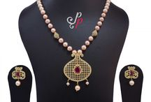 Stylish and Traditional Pink Pearl Necklace Set at Rs. 4,500