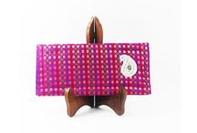 Clutches - (Ruby polka dots) / Shopibiz presents new designer clutches. Made from ruby brocket fabric with red, green, golden polka dots. This slim clutch is perfect to carry your wallet; phone, keys and cards etc. and a few more essentials.  http://shopibiz.com/index.php?route=product/product&product_id=67