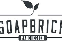 We are a stockist for Soapbrick Manchester / At SOAPBRICK we like to do everything possible from scratch and we like to draw on the natural creative talents of the individuals involved in this journey. We believe all this time and effort will bring you a product that will stand out both aesthetically and ecologically.