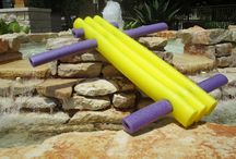 """Li'l X-3 FLOATEEZ / Li'l X-3 FLOATEEZ (45"""" long x 45"""" wide, 3 main yellow logz.) Generally suggested for children and adults up to 200 lbs., but they can still be functional and fun for people who are smaller or bigger!  Everyone does not have the same shape, size or weight - the same should hold true for your floatation device or water float. Our unique expandable design allows the user an option to select more, or less, buoyancy in the water."""