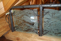 Railings with custom art glass and some with custom metal as well / We can provide decorative glass for railings with wood or metal supports. We can provide the supports. Custom and standard frames are available