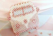 sy med perler
