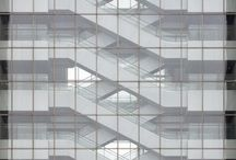 Elevation glass grid / Straight on elevation of a subject with a glass grid wall. Close crop of building with facade going to all edges of photo frame. Parallel vertical and horizontal lines.