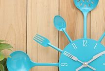 Kitchen Utensil Wall Clocks / Wall clocks with kitchen utensils like these are a budget-friendly way to add a fun focal wall to your busiest room (that being the kitchen). Don't you love the turquoise clock?