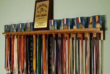 4 Foot Medal Awards Rack Trophy Shelf / MedalAwardsRack.com -Ships in 1-3 Business Days! -37 pegs to accommodate lanyard ribbon medals -Dual Groove shelf design to accommodate up to 18 pin style cased medals -Top shelf for the placement of trophies, plaques or other accolades -100% Satisfaction Guaranteed -US Patent Pending Display Shelf, Medal Awards Rack, Trophy Shelf, Sport Awards, Running Medals, Display the hardware you have worked so hard to earn!