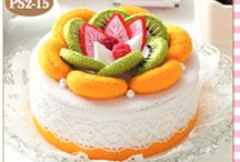 Kiwi  felted cake with fruit on top