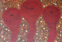 """RAELENE WILLIAMS / Raelene Williams Ngala was born around 1964 in central Australia in Alice Springs. She is a member of the Tangentyere Council research team.  Her unique and distinctive paintings represent the Ingkwelaye """"Walpa Pukla"""" or Whirly Winds.  Whirly winds are a phenomena in the desert that range in size from half a metre to ten metres in width and can get up to one thousand metres high."""