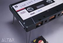 Big Tape / This exact replica of an 80's tape was commissioned by Budapest showroom 'Rock'n'Roll Interiors'. Unlike distantly similar objects out there, this cassette is an exact 1:10 scale replica of the classic MC.It is made out of MDF, and features iron legs, plus 130 meters of satin as tape (very child-friendly). It can be ordered in several colors, and designs. Contact us with your ideas!