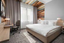 Hotel rooms / Zapraszamy do nowo otwartego Hotelu w Brzegu! Duże i wygodne łóżka, nowoczesny design i miła atmosfera w samym sercu Brzegu. 60 komfortowych pokoi: 30 TWIN, 22 QUEEN, 5 EXECUTIVE, 2 JUNIOR SUITE oraz 1 SUITE.  **********  We invite you to visit newly opened Hotel in Brzeg! Big and comfortable beds, modern design and cosy atmosphere in the heart of Brzeg. 60 comfortable rooms: 30 TWIN, 22 QUEEN, 5 EXECUTIVE, 2 JUNIOR SUITES and 1 SUITE.