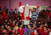 Santa Claus helps children of the world / Every year the Santa Claus Foundation makes a considerable donation by giving the Santa's Gift to the children of the world.