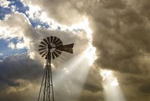 Windmills / Standing alone, silhouetted against the sky, a life line for people and animals