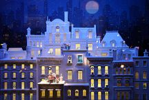 Tiffany's Christmas Windows 2013 New York / Tiffany's Christmas Windows 2013 brings windows that reflect a dream Manhattan roofscapes.  Dollhouse miniature homes stack upon each other in a nod to Paris style in white.  The display features Tiffany signature point spotlit jewels and beautiful subtle detailing.  Read more at: http://designlifenetwork.com