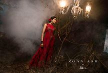 Red Rose / Regal red sleeveless Chantilly lace gown decorated with zardosi and sequins work featuring a boat neck surrounded by red and copper colored metallic roses.