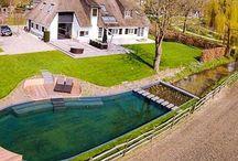 Zwemvijvers / Neemt u een frisse duik in onze zwemvijvergalerij? Al 15 jaar legt vijvercentrum De Scheper de mooiste zwemvijvers aan.