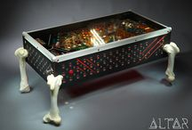 THE BEAST Coffee Table / This luxury spider-like monster with its premium black leather covering, metal rivets and wonderful claw marks is a real hardcore piece of the Arcade Furniture. The pinball playfield is from the Arena pinball built by Gottlieb in 1987. In addition, the legs are made of real bull bones wich preparation took for a mere two weeks. The playfield has two lighting programs and also an intro music from the original machine.