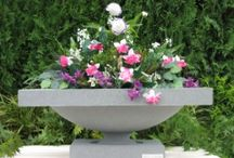 Outdoor Garden Statues / The Hampton Jardiniere Assembly is a step up from our more basic designs, bringing a more ornate presentation to your outdoor space. Complete with claw-foot base, and latticed pattern of the planter that has incredible detail of a woven basket. http://www.thegardenfountainstore.com/