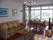 Villa Marina / Villa Marina is a spacious apartment which has modern continental fittings and comfortable furniture. The open plan living/dining room with magnificent views of Table Mountain leads to an enclosed balcony where you can enjoy evening drinks and soak up the mountain views. There is also a glimpse of the sea from the bedroom and kitchen.