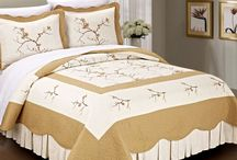Bed Spreads / Bedspread are blankets that cover the top of a bed but mostly used for decoration and not for sleeping in. Most bedspreads you can still sleep in but a bed sheet is recommended to enjoy softness. But most people take a bed spread off of the bed before going to sleep. Basic bedspread will fall all the way to the floor, or be quilted, or will ahve ruffles.