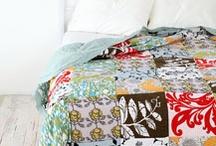 Tapetes, patchwork, almofadas e puffs