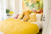 Mellow Yellow Bedroom / Ideas for my mom's bedroom makeover: 1.  Mellow yellow walls 2.  Floral curtains with pops of bright, warm colors 3.  Closet mural / wall mural 4.  Crisp white/cream white bedding, with throw pillows that echo accents in curtains 5.  Palladian blue / eau de nil furniture pieces/doors with gold trim 6.  East meets west coordinated through use of gold.