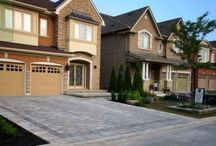 Flagstone Pool Deck with Pergola, Driveway, and Deck