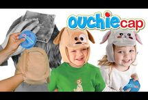 Ouchie Cap Videos! / Check out our commercial and see how the Ouchie Cap makes kids ice packs & heat packs hands free and sting free!