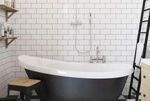 Black and White Bathrooms / A very modern look for the bathroom is a strict black and white feel. But it doesn't have to be cold or stark.