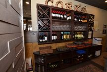 P&M's Wine Racks and so much more! / Our designer, Paul, relished in the opportunity to work with local restaurant owner, Junior, from P&M's Kouzzina. Together they created this functional, modern space... a wine aficionados dream! #maple #custom-built #LaCuisineKitchenCabinets #BuyLocal