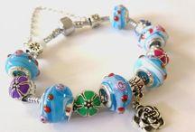 ♥ Positively Charming -Bracelets / by Rebecca Jayne