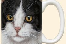 Cat Mugs / Here are our unique range of cat mugs. They are hand printed in the USA by Fiddler's Elbow who take pride both in the quality of their manufacture and for commissioning the artists to create these unique designs.