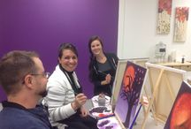 Our guest having fun with paint and wine!
