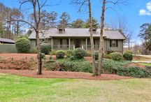 890 Hillwood Drive, Marietta GA / Listing Agent: GLENNDA L BAKER; (678) 755-3711; glennda@glennda.net; Renovated Ranch w/ finished terrace level in Indian Hills, East Side, Dickerson, Walton!  Enjoy the charming front porch or relax on the screen porch, overlooking completely fenced backyard! Vaulted great room w/ cozy brick fireplace, open dining room, renovated kitchen w/ granite & stainless appliances & breakfast area. Master retreat w/ trey ceiling, his & her closets, renovated bath w/ granite, travertine & seamless shower.