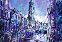 Utrecht & Groningen / Vlotte penseelstreken en kleurrijke accenten resulteren in energieke schilderijen van Utrecht en Groningen.