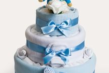 Nappy Cakes - Baby Boy / Our thoughtful baby blue nappy cakes are a great pregnancy gift for the expectant mum. Our cakes come in a range of sizes and themes, with baby essential items, and some include keepsakes to help treasure those early days.